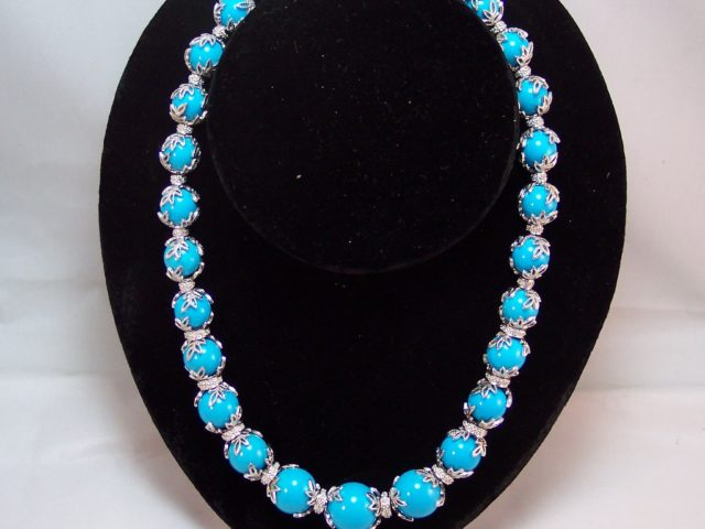 14k w/g designer strand of large turquoise beads