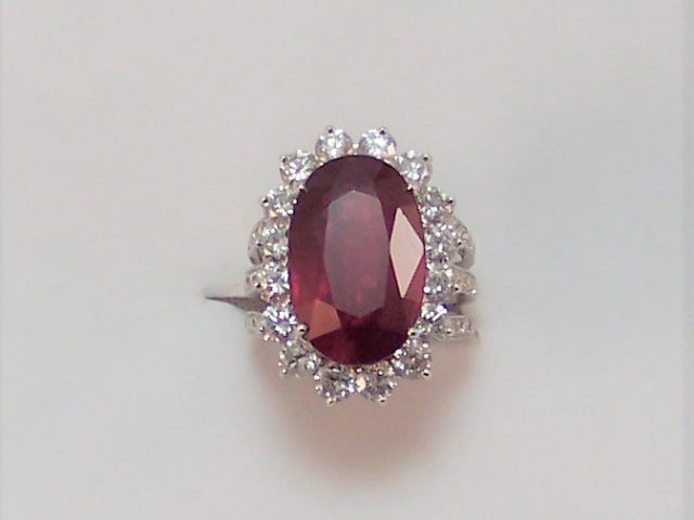 18K w/g ring with 25ct ruby center with 2.00ct diamonds around